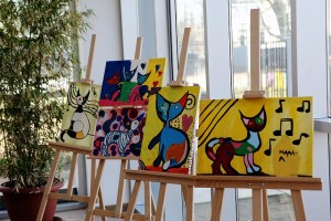 paintings of cats on canvases