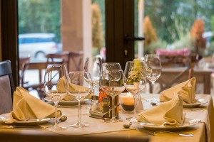 a clean fine dining restaurant with wine glasses on the table